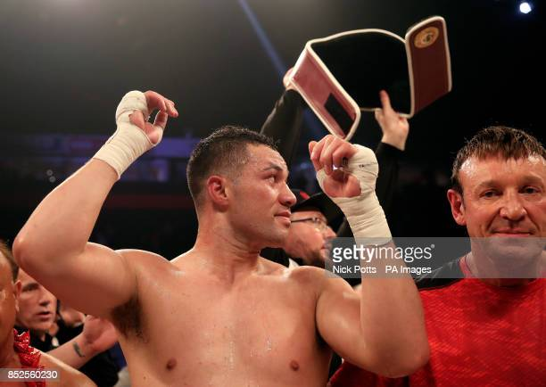 Joseph Parker celebrates victory over Hughie Fury as his belt his taken from him after the WBO World Heavyweight Title bout at Manchester Arena