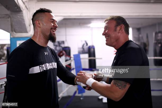Joseph Parker has his hands wrapped by trainer Kevin Barry before a training session on May 2 2017 in Auckland New Zealand Parker will fight Razvan...
