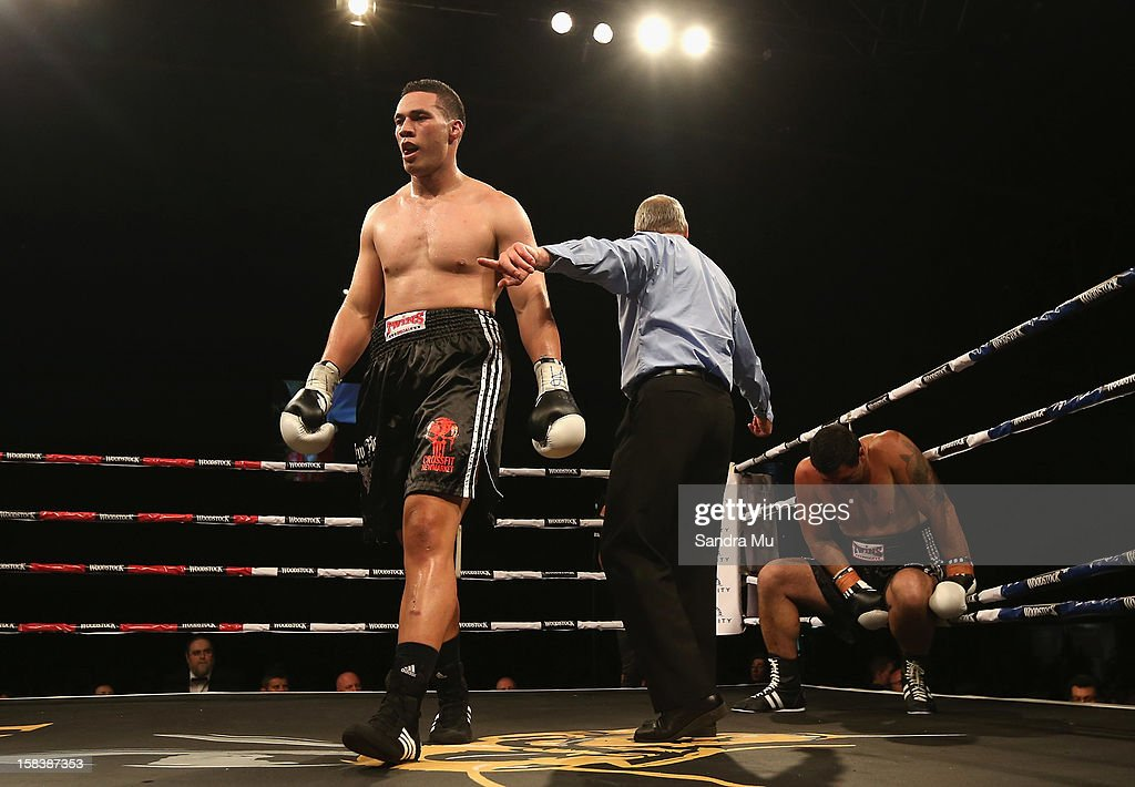 Joseph Parker (L) is sent to the corner during the professional bout between Joseph Parker and Richard Tutaki during the 2012 Fight for Life at Trusts Stadium on December 15, 2012 in Auckland, New Zealand.