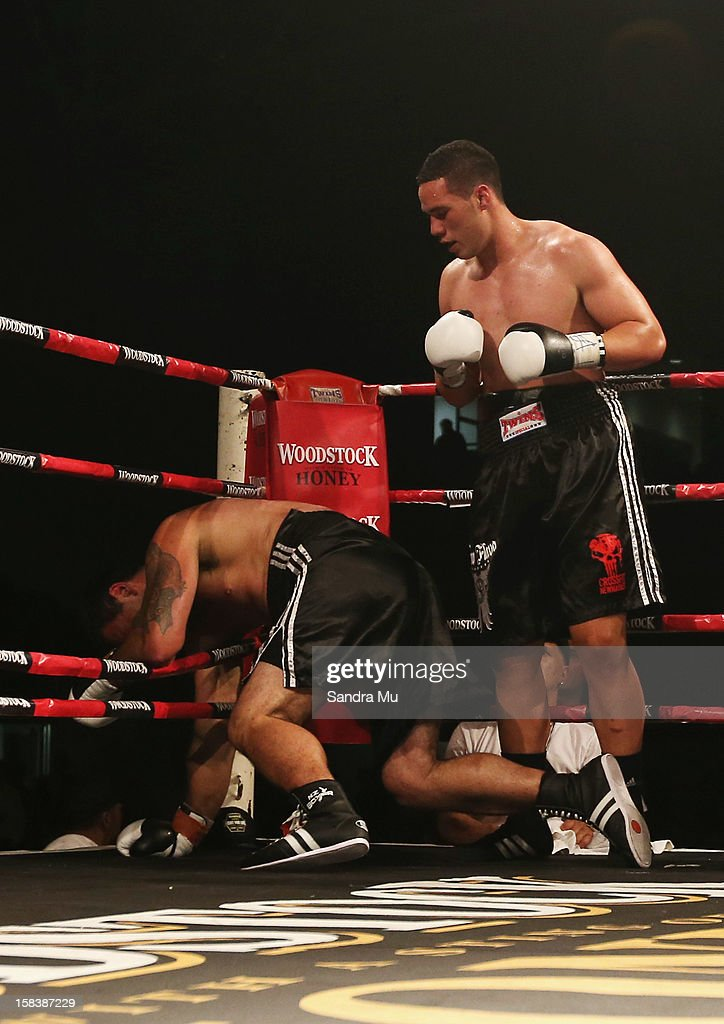 Joseph Parker (R) knocks down Richard Tutaki during the professional bout between Joseph Parker and Richard Tutaki during the 2012 Fight for Life at Trusts Stadium on December 15, 2012 in Auckland, New Zealand.