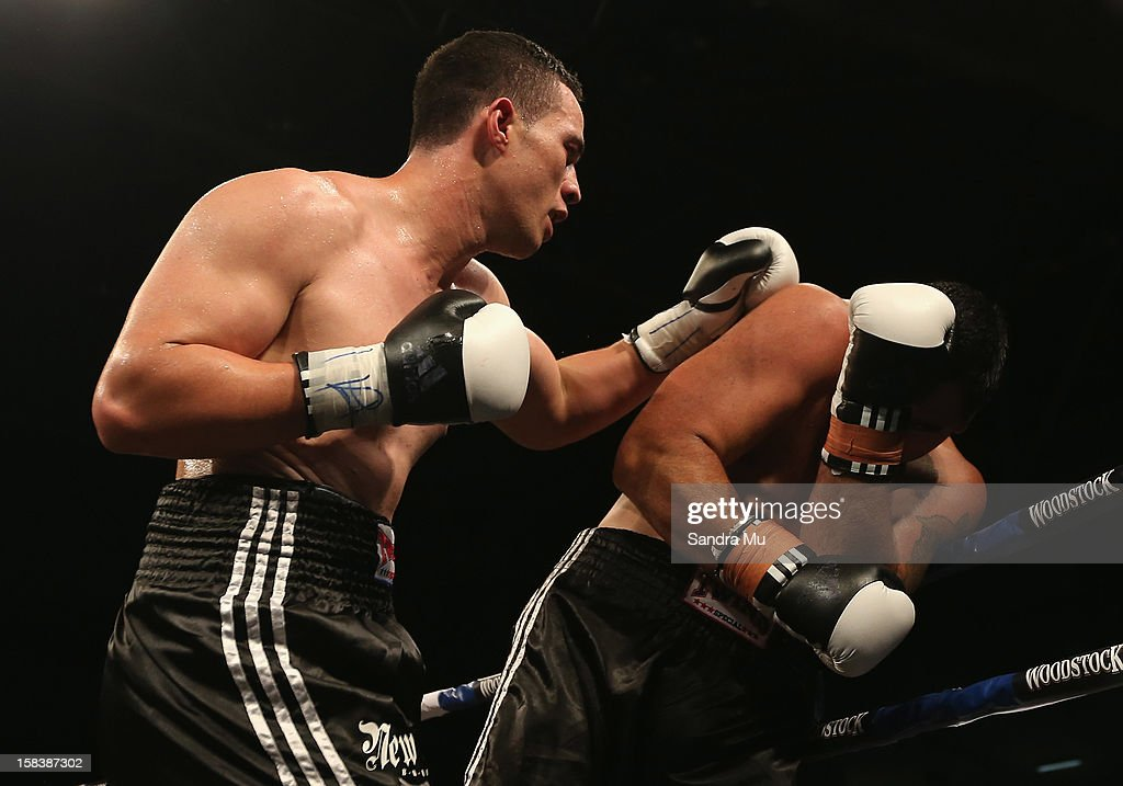 Joseph Parker (L) punches Richard Tutaki during the professional bout between Joseph Parker and Richard Tutaki during the 2012 Fight for Life at Trusts Stadium on December 15, 2012 in Auckland, New Zealand.
