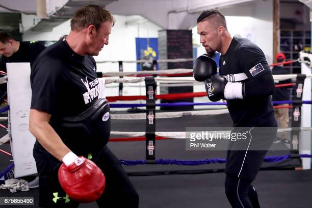 Joseph Parker spars with his trainer Kevin Barry during a training session on May 2 2017 in Auckland New Zealand Parker will fight Razvan Cojanu in...