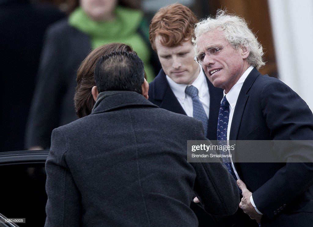 Joseph Patrick Kennedy III (C) and Joe Kennedy Jr. (R) arrive for the funeral of Sargent Shriver at Our Lady of Mercy Catholic Church January 22, 2011 in Potomac, Maryland. Robert Sargent Shriver Jr., a politician and activist who was the first leader of the Peace Corps and was involved in other social programs, died this week at the age of 93.