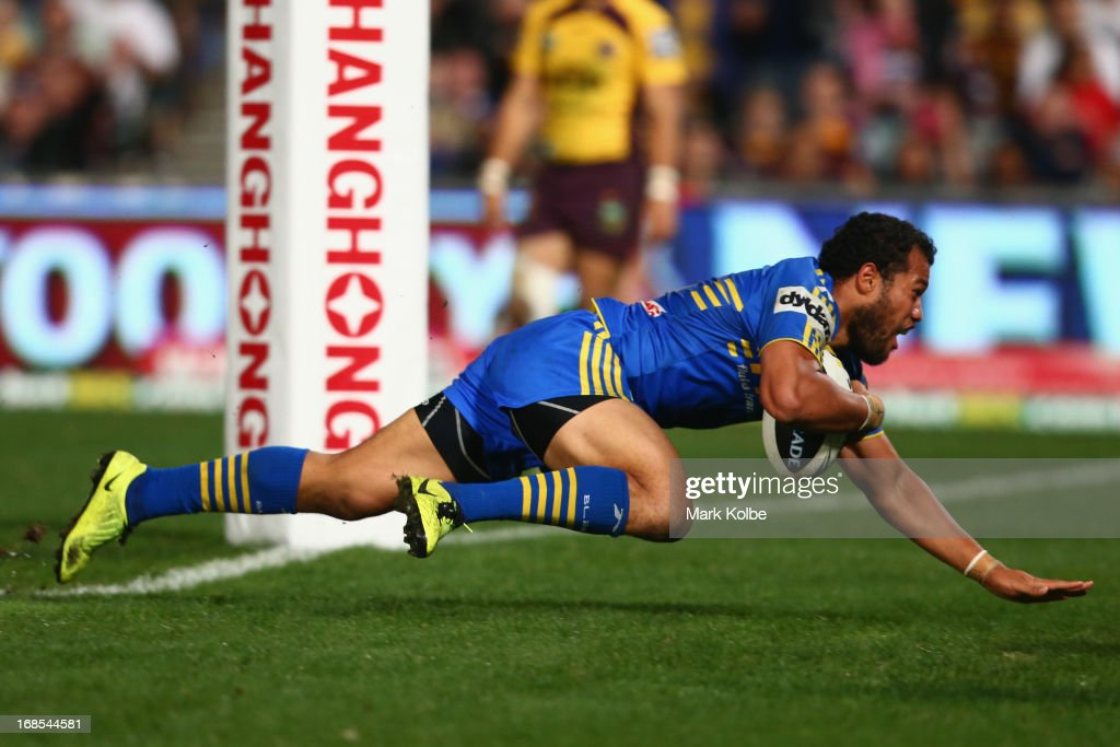 Joseph Paulo of the Eels dives over to score a try during the round nine NRL match between the Parramatta Eels and the Brisbane Broncos at Parramatta Stadium on May 11, 2013 in Sydney, Australia.