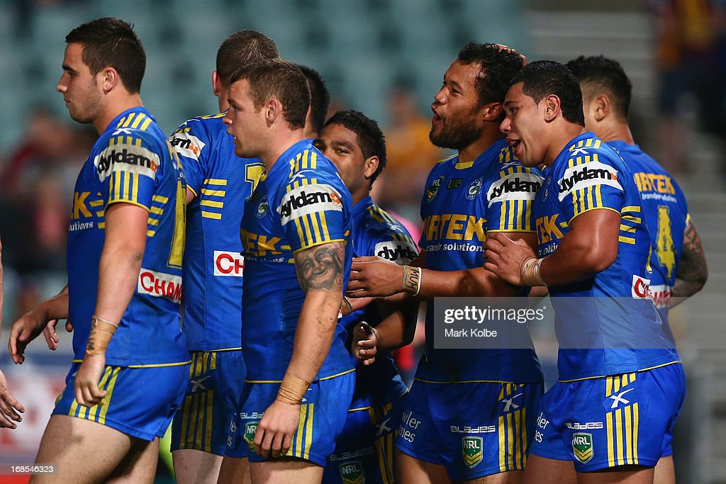 Joseph Paulo of the Eels is congratulated by his team mates after scoring a goal during the round nine NRL match between the Parramatta Eels and the Brisbane Broncos at Parramatta Stadium on May 11, 2013 in Sydney, Australia.