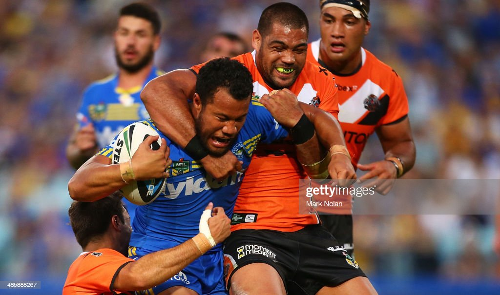 Joseph Paulo of the Eels is tackled by Adam Blair of the Tigers during the round seven NRL match between the Parramatta Eels and the Wests Tigers at ANZ Stadium on April 21, 2014 in Sydney, Australia.