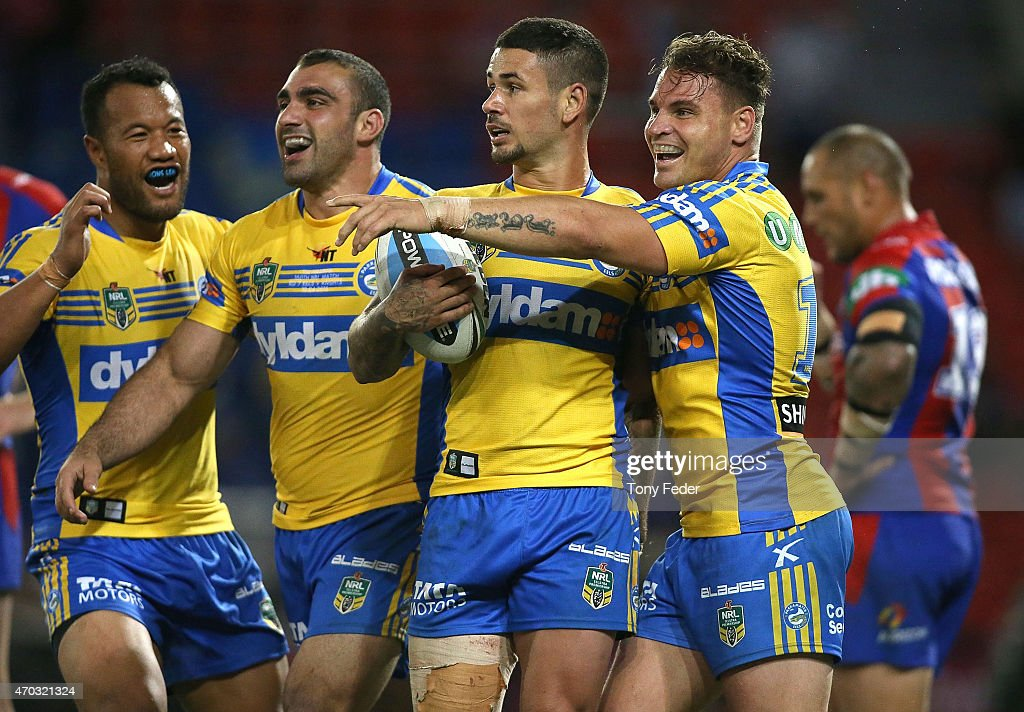 Joseph Paulo, Tim Mannah, Nathan Peats and Anthony Watmough of the Eels celebrate a try during the round seven NRL match between the Newcastle Knights and the Parramatta Eels at Hunter Stadium on April 19, 2015 in Newcastle, Australia.