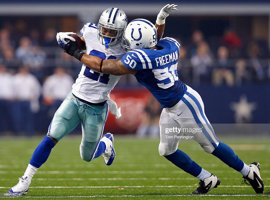 <a gi-track='captionPersonalityLinkClicked' href=/galleries/search?phrase=Joseph+Randle+-+American+Football+Player&family=editorial&specificpeople=11331012 ng-click='$event.stopPropagation()'>Joseph Randle</a> #21 of the Dallas Cowboys carries the ball against <a gi-track='captionPersonalityLinkClicked' href=/galleries/search?phrase=Jerrell+Freeman&family=editorial&specificpeople=5441871 ng-click='$event.stopPropagation()'>Jerrell Freeman</a> #50 of the Indianapolis Colts at AT&T Stadium on December 21, 2014 in Arlington, Texas.