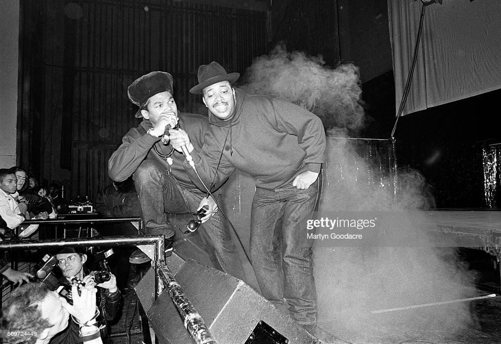 Joseph 'Run' Simmons and Darryl 'DMC' McDaniels perform on stage in London United Kingdom 1990