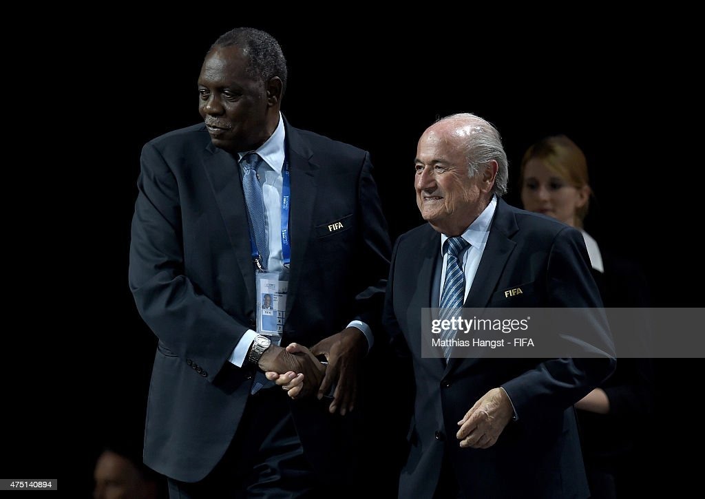 Joseph S Blatter celebrates with FIFA Senior Vice President Issa Hayatou of Cameroon as he is reelected as FIFA President after Presidential...
