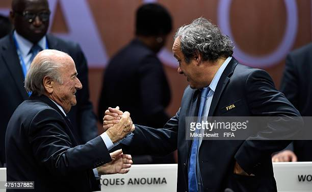 Joseph S Blatter is congratulated by UEFA President Michel Platini of France as he is reelected as FIFA President after Presidential candidate HRH...