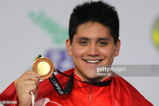 Joseph Schooling of Singapore poses with his Gold Medal after he won it during the Men 100m Butterfly Final at the Aquatic Centre as part of the 2017...