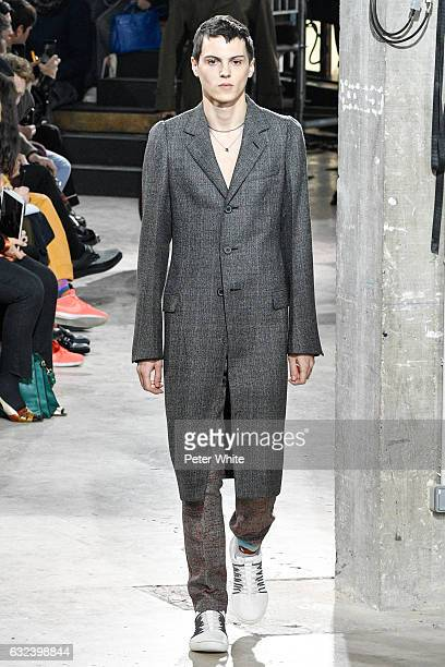 Joseph Signoret walks the runway during the Lanvin Menswear Fall/Winter 20172018 show as part of Paris Fashion Week on January 22 2017 in Paris France