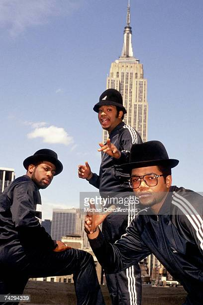 Joseph Simmons Darryl McDaniels and Jam Master Jay of the hiphop group 'Run DMC' pose for a portrait session wearing Addidas sweat suits in front of...