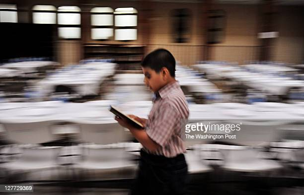Joseph Soltani paces while reading the Quran just before iftar at the Dar alHijrah Mosque on Aug 16 in Falls Church VA The mosque's name literally...