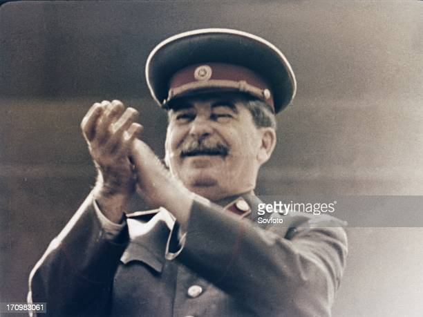 Joseph stalin applauding the red army during a may day parade in red square in 1949