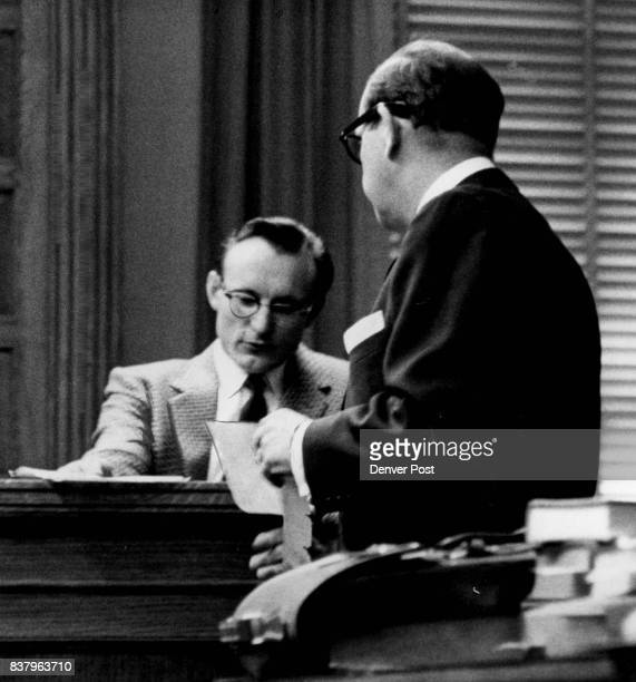 Joseph T Grande employe for Ryall Electric Supply Co is questioned by District Attorney Bert M Keating as he says John Gilbert Graham bought a timing...