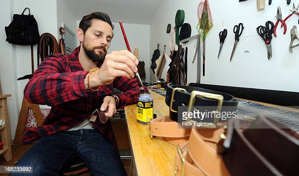 Joseph Tanner and his leather business 'Stars and perfect tens'Tanner applying dye to the edge of a leather key strap with brass ring RICK...