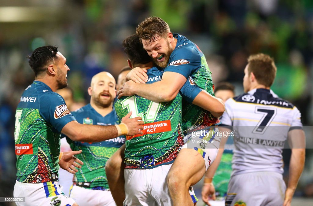 Joseph Tapine is congratulated by Jordan Rapana and Elliot Whitehead of the Raiders after scoring during the round 17 NRL match between the Canberra Raiders and the North Queensland Cowboys at GIO Stadium on July 1, 2017 in Canberra, Australia.