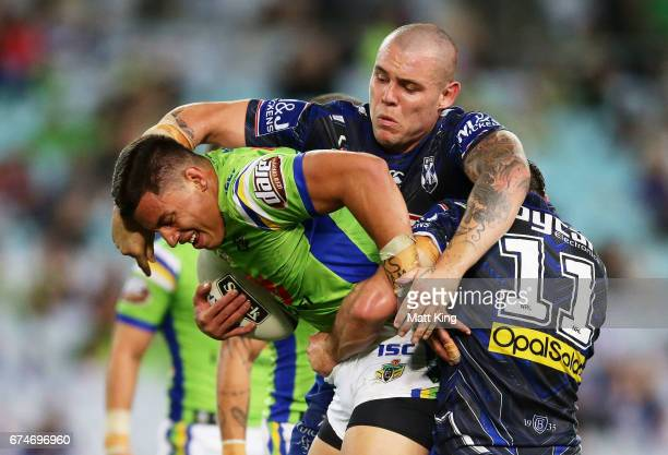 Joseph Tapine of the Raiders is tackled by David Klemmer of the Bulldogs during the round nine NRL match between the Canterbury Bulldogs and the...