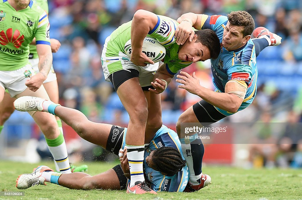 Joseph Tapine of the Raiders is tackled during the round 16 NRL match between the Gold Coast Titans and the Canberra Raiders at Cbus Super Stadium on June 26, 2016 in Gold Coast, Australia.