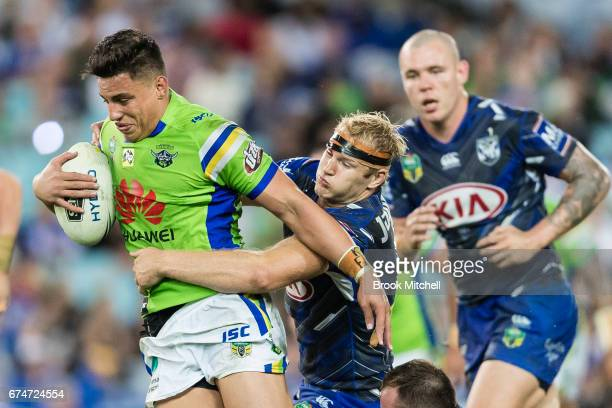Joseph Tapine of the Raiders is tackled during the round nine NRL match between the Canterbury Bulldogs and the Canberra Raiders at ANZ Stadium on...