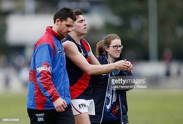 Joseph Tegart of Coburg is taken from the field after being injured during the round 18 VFL match between Collingwood and Coburg at The Holden Centre...