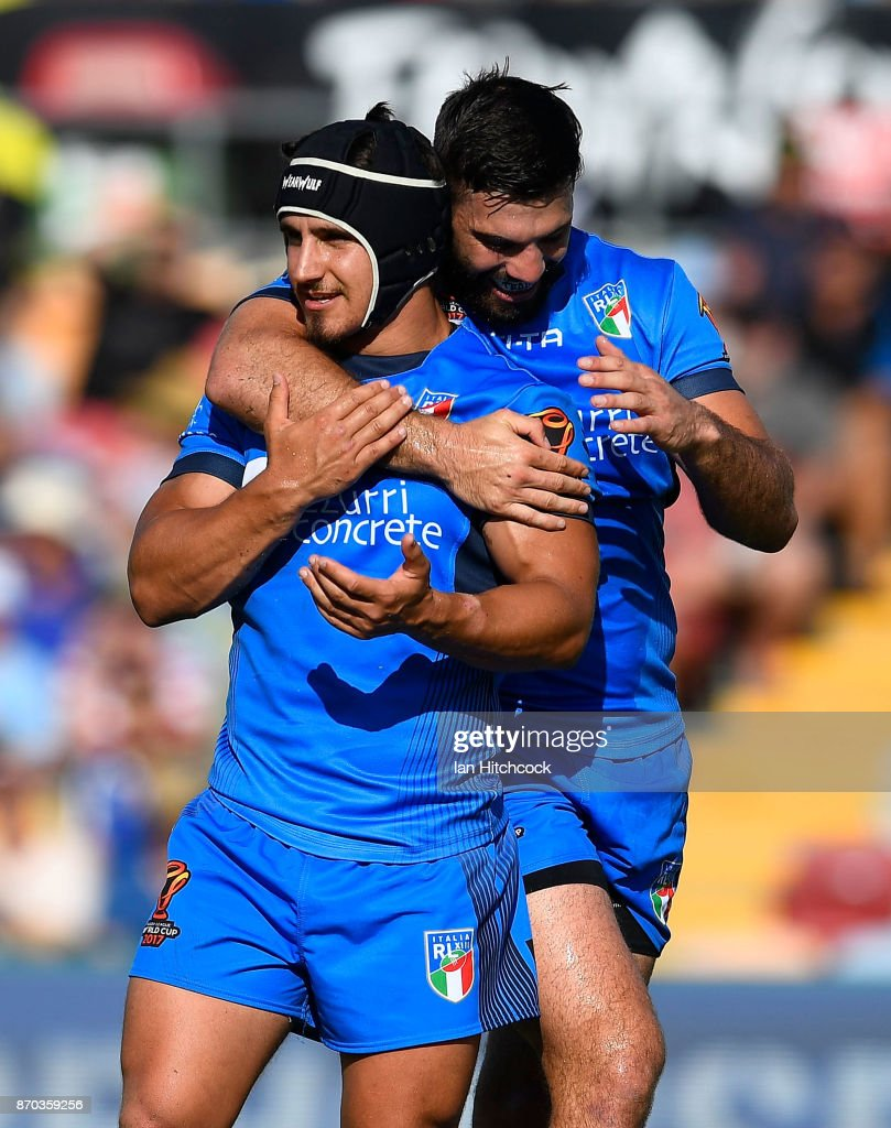 Joseph Tramontana (L) of Italy celebrates after scoring a try with James Tedesco of Italy during the 2017 Rugby League World Cup match between Italy and the USA at 1300SMILES Stadium on November 5, 2017 in Townsville, Australia.