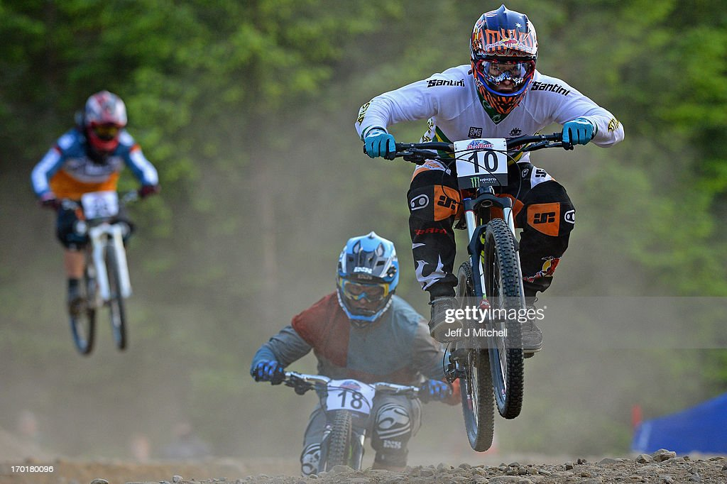 Joseph Vejvoda and Will Evans compete in the men's four cross pro tour qualification at the UCI Mountain Bike World Cup on June 8, 2013 in Fort William, Scotland.