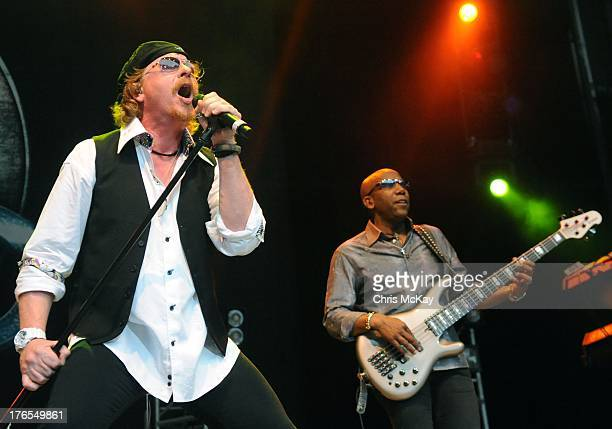 Joseph Williams and Nathan East of Toto perform at Chastain Park Amphitheater on August 14 2013 in Atlanta Georgia
