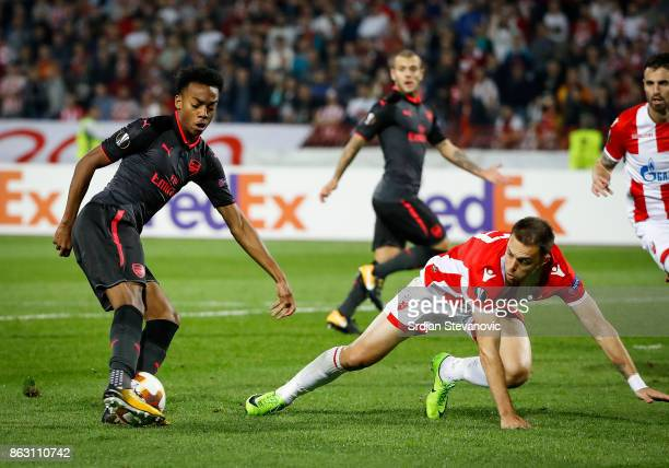 Joseph Willock of Arsenal in action against Milan Rodic of Crvena Zvezda during the UEFA Europa League group H match between Crvena Zvezda and...