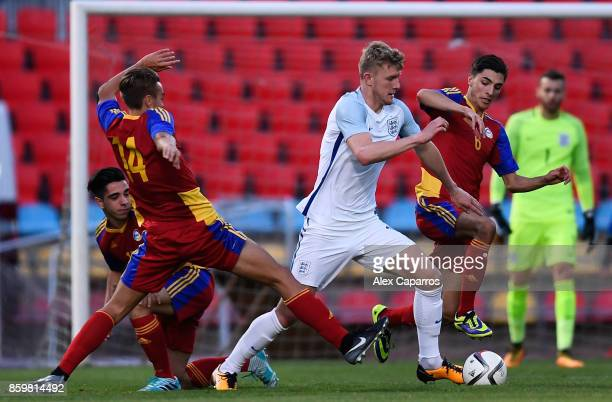 Joseph Worrall of England goes past Albert Grau Samper of Andorra and Alex Villagrasa of Andorra during the UEFA European Under 21 Championship...