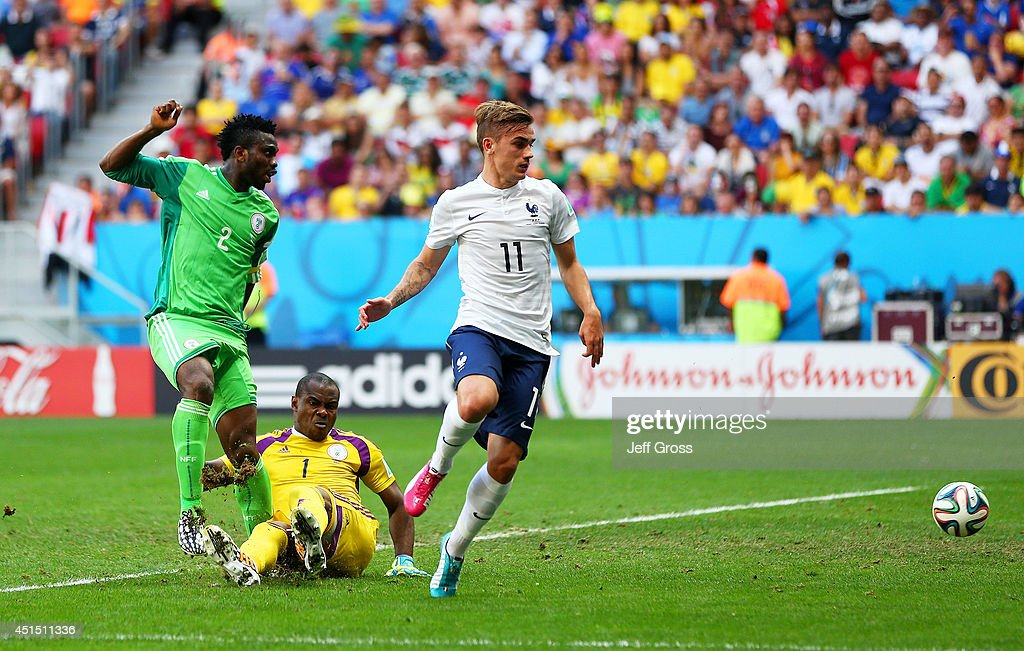 <a gi-track='captionPersonalityLinkClicked' href=/galleries/search?phrase=Joseph+Yobo&family=editorial&specificpeople=220395 ng-click='$event.stopPropagation()'>Joseph Yobo</a> of Nigeria (L) scores an own goal as goalkeeper <a gi-track='captionPersonalityLinkClicked' href=/galleries/search?phrase=Vincent+Enyeama&family=editorial&specificpeople=831392 ng-click='$event.stopPropagation()'>Vincent Enyeama</a> and <a gi-track='captionPersonalityLinkClicked' href=/galleries/search?phrase=Antoine+Griezmann&family=editorial&specificpeople=7197539 ng-click='$event.stopPropagation()'>Antoine Griezmann</a> of France look on during the 2014 FIFA World Cup Brazil Round of 16 match between France and Nigeria at Estadio Nacional on June 30, 2014 in Brasilia, Brazil.