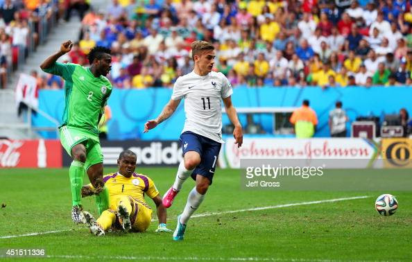 Joseph Yobo of Nigeria scores an own goal as goalkeeper Vincent Enyeama and Antoine Griezmann of France look on during the 2014 FIFA World Cup Brazil...