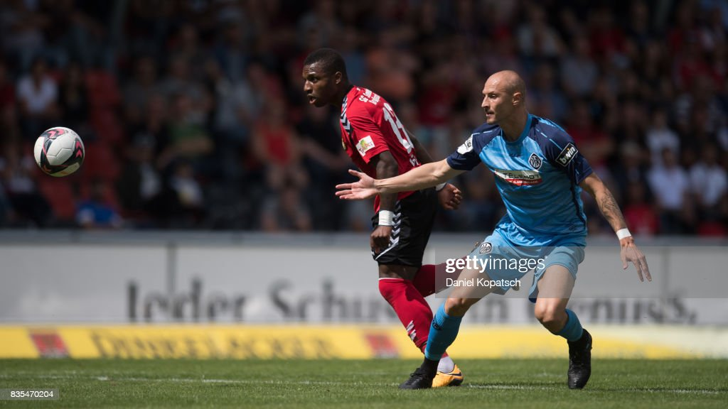Joseph-Claude Gyau of Grossaspach (R) is challenged by Matthias Morys of Aalen during the 3. Liga match between SG Sonnenhof Grossaspach and VfR Aalen at on August 19, 2017 in Grossaspach, Germany.