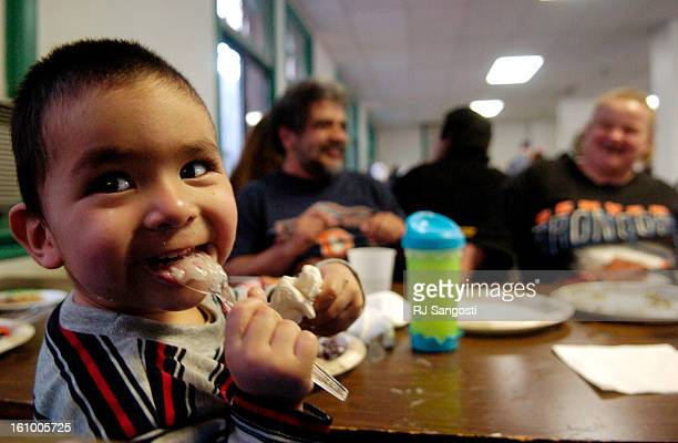 CO DEC 25 2005 Joseph<CQ> Gonzales<CQ> Jr 20monthsold who's family lives at the Olin Hotel Apartments was served Christmas dinner by the Community of...