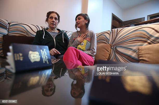 Josephine Abu Assaleh talks with her niece in Damascus on January 30 2017 after they returned home with their family members after being refused...