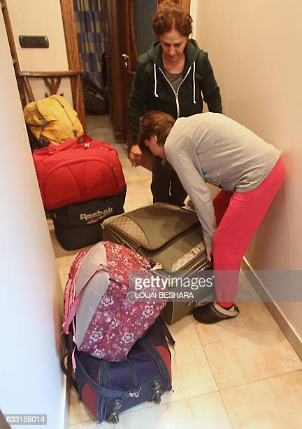 Josephine Abu Assaleh unpacks their suitcases with her neice in Damascus on January 30 2017 after they returned home with their family members after...
