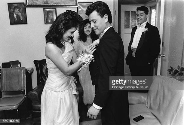 Josephine Alvarez pins a boutonniere on her prom date Chicago Illinois May 6 1988