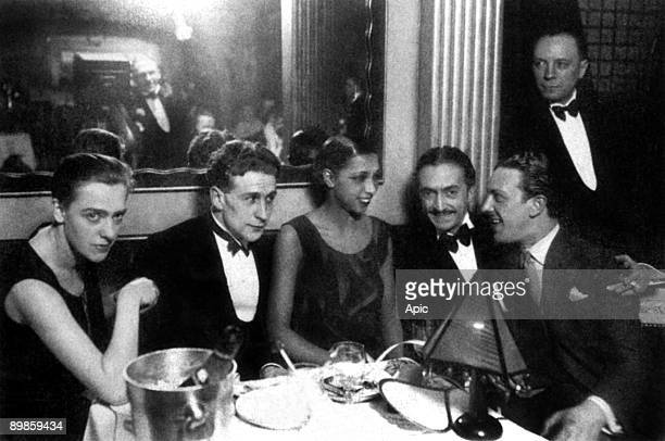 Josephine Baker with writer Georges Simenon and his wife Tigy and her fiancee and agent Guiseppe Abatino called Pepito around 1928 on her restaurant...