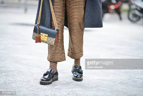 Josephine Bredsted poses wearing Ganni total look and Gucci bag before the Costume National show during the Milan Fashion Week Fall/Winter 2016/17 on...