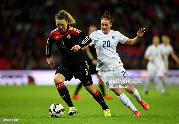 Josephine Henning of Germany and Jodie Taylor of England compete for the ball during the Women's International Friendly match between England and...