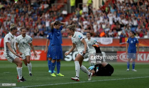 Josephine Henning of Germany celebrates after she heads the opening goal during the Group B match between Germany and Italy during the UEFA Women's...