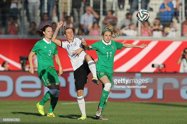 Josephine Henning of Germany fights for the ball with JulieAnn Russel and Megan Campell of Ireland during the FIFA Women's World Cup 2015 qualifier...