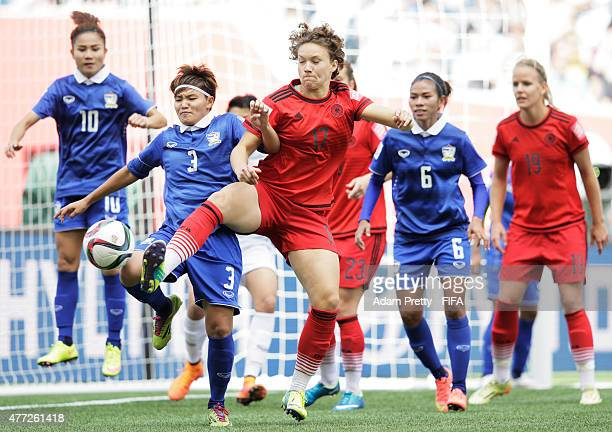 Josephine Henning of Germany is challegend by Natthakarn Chinwong of Thailand during the FIFA Women's World Cup 2015 Group B match between Thailand...