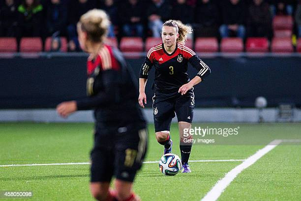 Josephine Henning of Germany passes the ball to Anja Mittag during the Women's international friendly between Sweden and Germany at Behrn Arena on...
