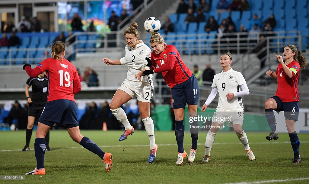 Josephine Henning (L) of Germany scores the 1:1 equalizer against Ada Hegerberg of Norway during the women's international friendly match between Germany and Norway at community4you ARENA on November 29, 2016 in Chemnitz, Germany.