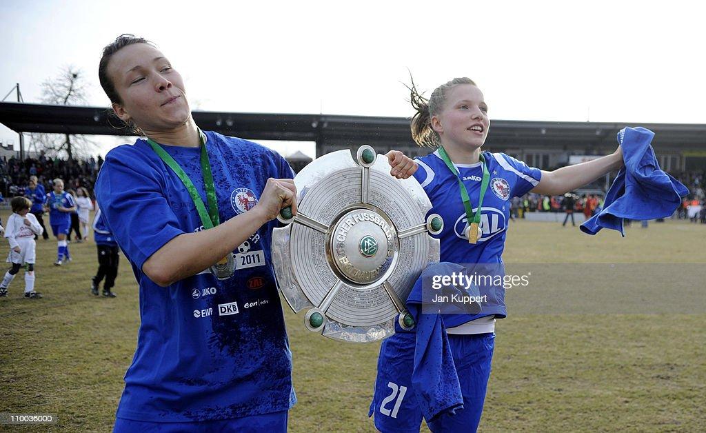 Josephine Henning (L) und Tabea Kemme (R) celebrate with the trophy after winning the Women Bundesliga match between Turbine Potsdam and Essen-Schoenebeck at the Karl-Liebknecht stadium on March 13, 2011 in Potsdam, Germany.