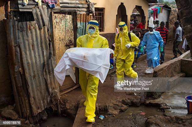 Josephine Sesay carries a deceased 7month old baby from Race Course area after she died in Freetown Sierra Leone on Sunday November 23 2014 Sesay a...