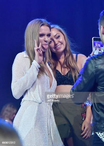Josephine Skriver and Brandi Glenn Cyrus attend the 2017 CMT Music Awards at the Music City Center on June 7 2017 in Nashville Tennessee